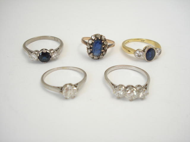 A collection of diamond and sapphire and diamond rings