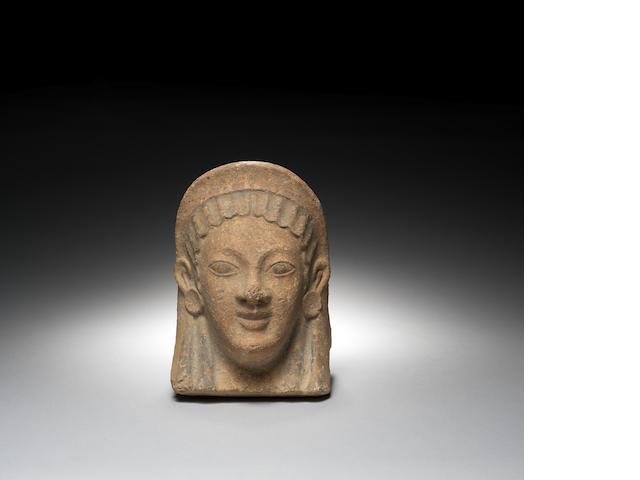 A large Etruscan terracotta antefix