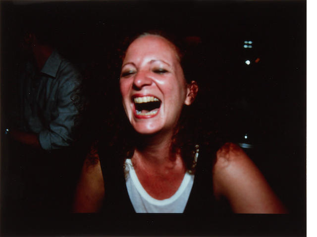 Nan Goldin (American, born 1953) Self-portrait laughing - Paris C-print, 1999, signed, titled and numbered 104/200 in blue ink, published by Partners in Health, New York, 405 x 509mm (15 x 20in)(I)(unframed)