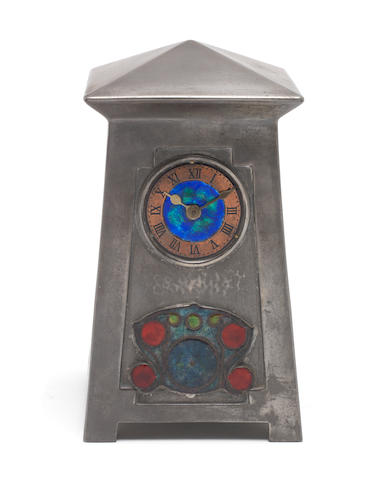 Archibald Knox for Liberty & Co. A Pewter and Enamel Clock, circa 1905