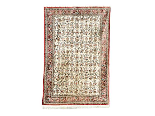 A silk Ghom carpet, Central Persia, 350cm x 240cm, signed