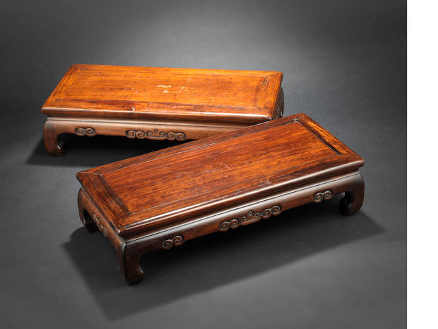 A pair of Chinese rosewood, or other wood, stands Qing Dynasty or later