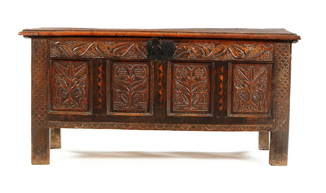 A Charles II oak carved and inlaid coffer Circa 1670