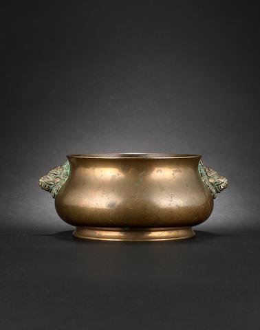 A metal, circular incense burner Xuande six-character mark