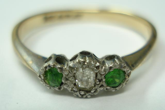An early 20th century demantoid garnet and diamond ring