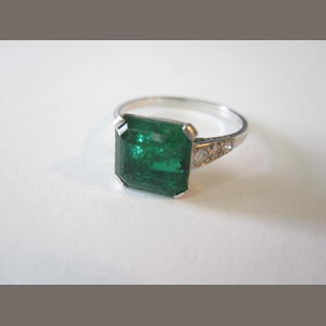 An emerald single-stone ring