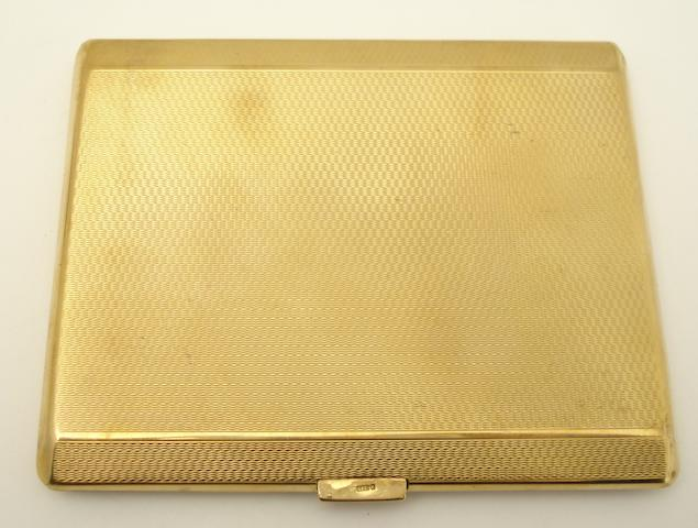 A 9ct gold cigarette case, Birmingham 1933