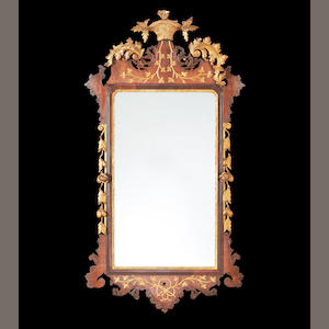 A 19th century mahogany and parcel gilt mirror in the George II style