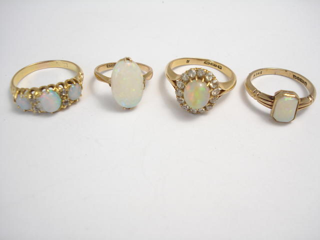 A collection of four opal rings