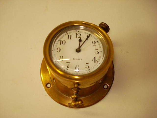 A brass cased 8-day car clock,