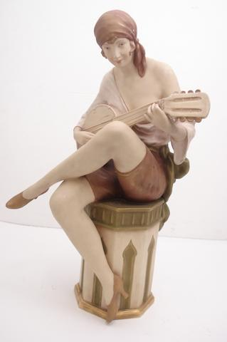 A Royal Dux figure of a lady playing a banjo