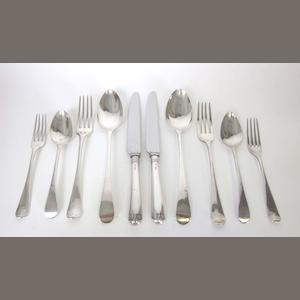 A matched silver Old English pattern table service of flatware predominately by Peter, Ann & William Bateman, London 1800 - 1803