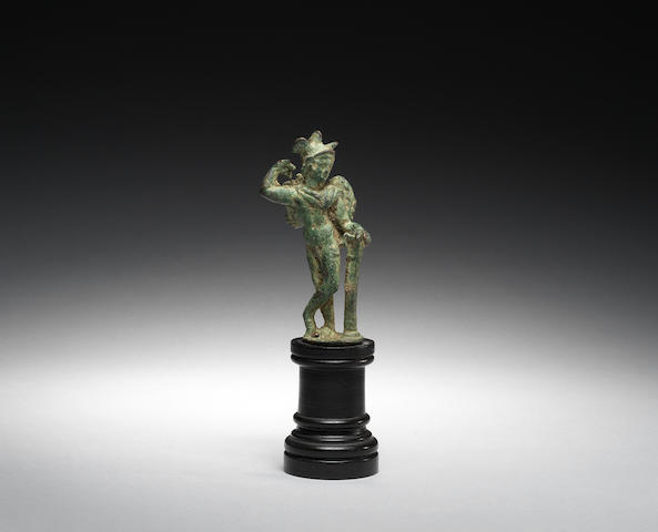 A Roman bronze figure of Eros