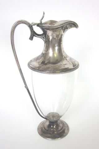A Victorian silver mounted glass claret jug by Walter & Charles Sissons, London 1880