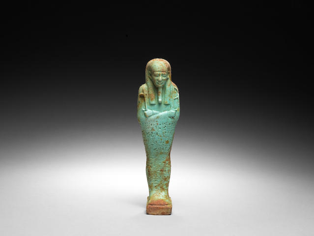 An Egyptian pale green glazed composition shabti