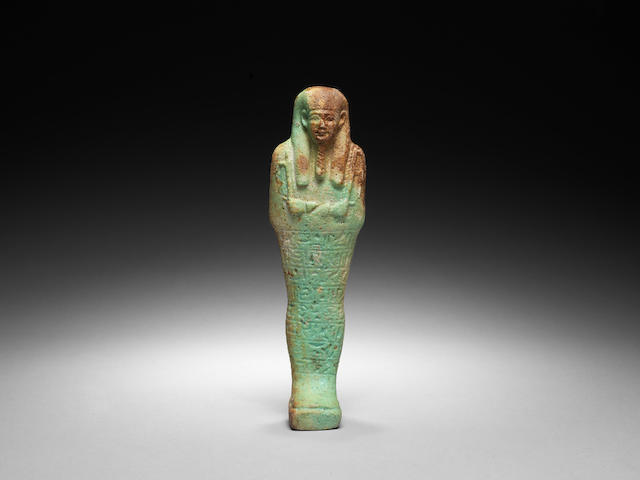 An Egyptian green glazed composition shabti