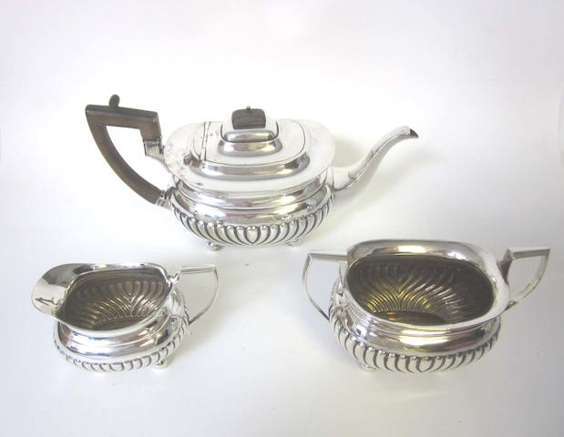 An Edward VII silver three-piece tea service by Holland, Aldwinkle & Slater, London 1901-03