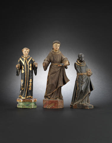 Three 17th and 18th century Spanish Colonial carved wood and polychrome decorated figures