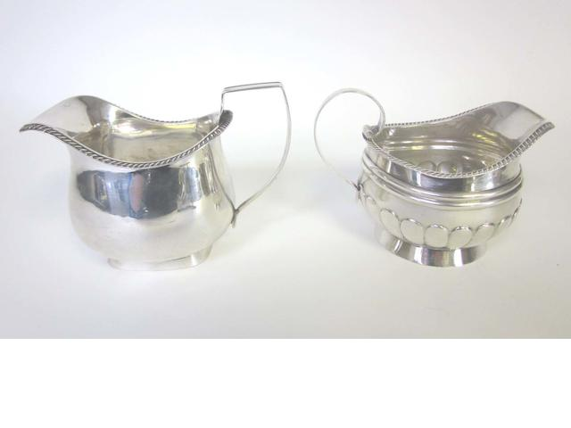 A George III provincial silver cream jug by Cattle & Barber, York 1812-13, together with a George IV example  (2)
