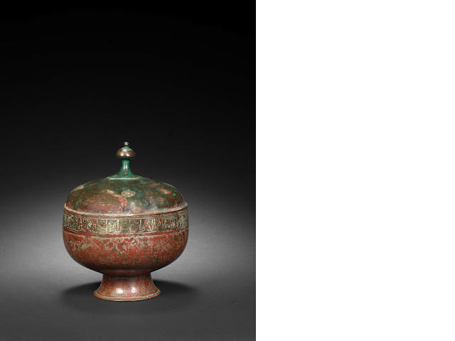 A lidded bronse silver inlaid vessel Iran 13th century