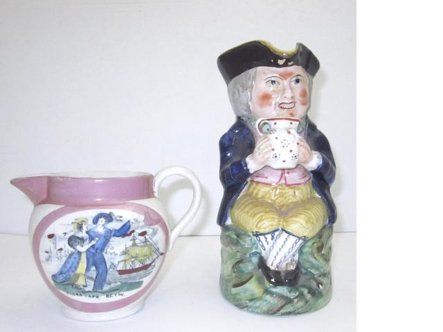 A pink lustre jug and a toby jug 19th century