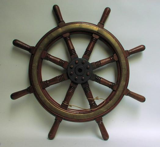 A Teak yacht's wheel 36ins. (92cm)diam.