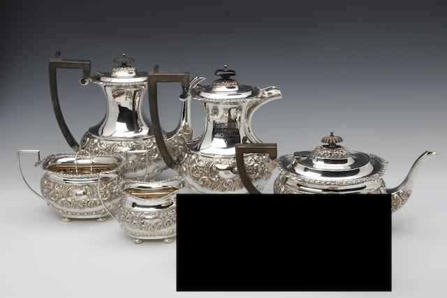 An Edwardian silver five piece presentation tea and coffee service by Nathan and Hayes, Chester 1903, hot water pot by the same maker, Birmingham 1904
