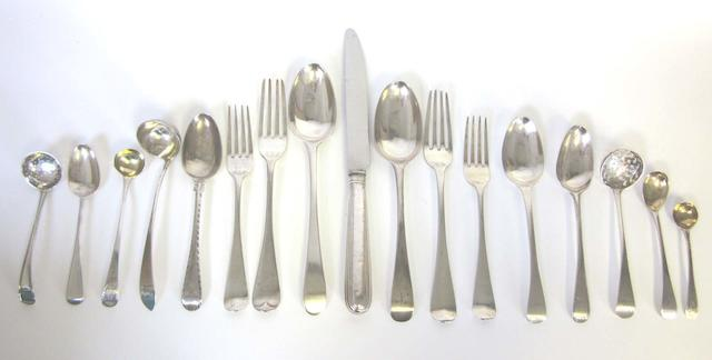 A matched silver Old English pattern service of flatware, predominately George III/IV various dates and maker's