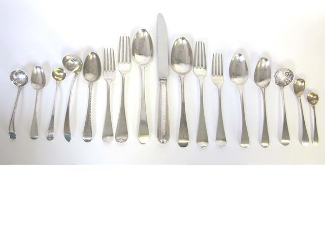 A matched silver Old English pattern service of flatware, predominately George III / IV various maker's and dates