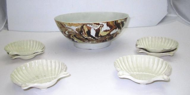 A set of six creamware shell dishes and an agateware bowl Late 18th century