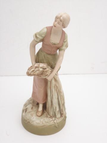 A Royal Dux figure of a girl Circa 1920