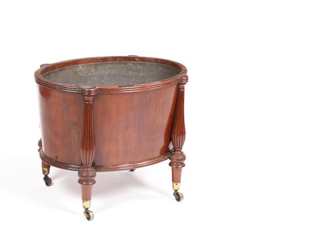 A George IV mahogany oval wine cooler