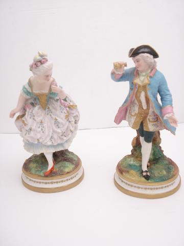 A pair of French bisque polychrome figures Circa 1900