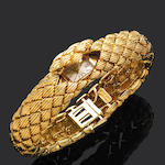 A gold bracelet watch,  by David Webb,