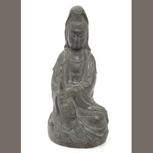A wooden seated Guanyin