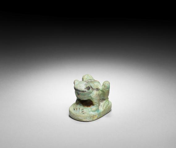 An Egyptian glazed composition frog