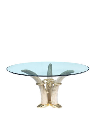 French Elephant Tusk Table circa 1975  gilt bronze and resin with glass top  Height: 67 cm.                26 3/8 in. Diameter: 139 cm.                  54 3/4 in.