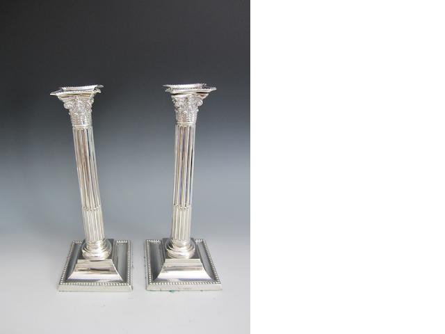 A Victorian pair of silver candlesticks by Martin Hall and Co., London 1886