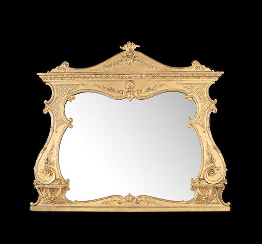 An Edwardian giltwood overmantel mirror in the Rococo revival style
