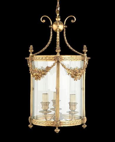 A Regency style gilt metal and glass hanging lantern