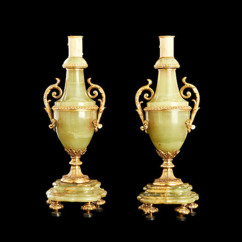 A pair of 20th century onyx and gilt metal mounted lampbases