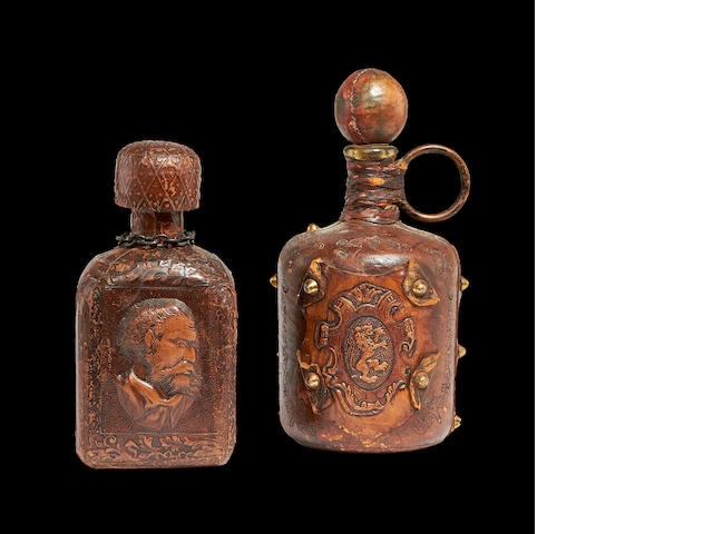 Two 19th century Spanish leather covered decanters