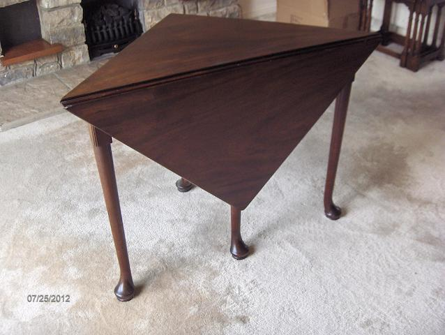 A 19th century mahogany corner tea table