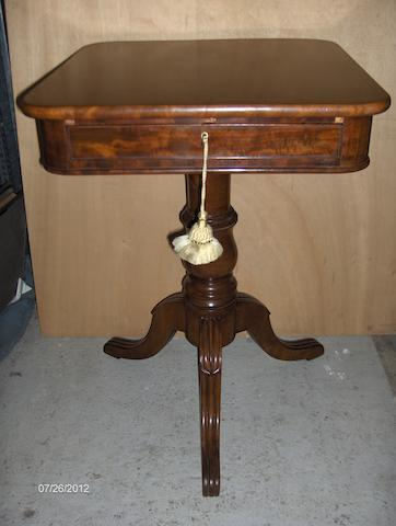 A mahogany pedestal work table