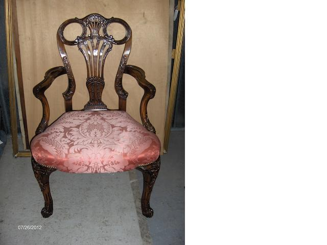 A pair of carved mahogany elbow chairs