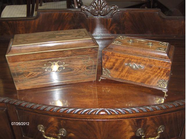 A Geo lll mahogany tea casket and a rosewood and brass inlaid tea casket.