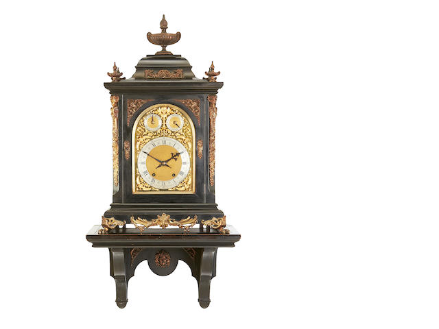 A Victorian ebonised and gilt metal mounted quarter striking bracket clock