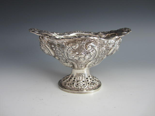 A Victorian oval pedestal basket by Charles Stuart Harris, London 1889