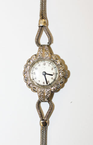 A ladies diamond set cocktail watch
