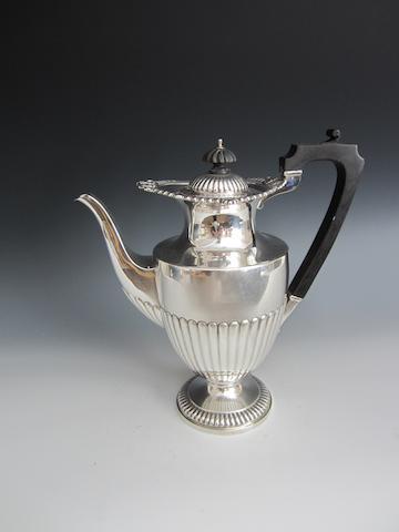 A silver vase shape pedestal coffee pot by Elkington and Co., Birmingham 1911